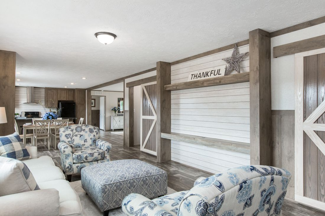 The THE BREEZE II Family Room. This Manufactured Mobile Home features 4 bedrooms and 2 baths.