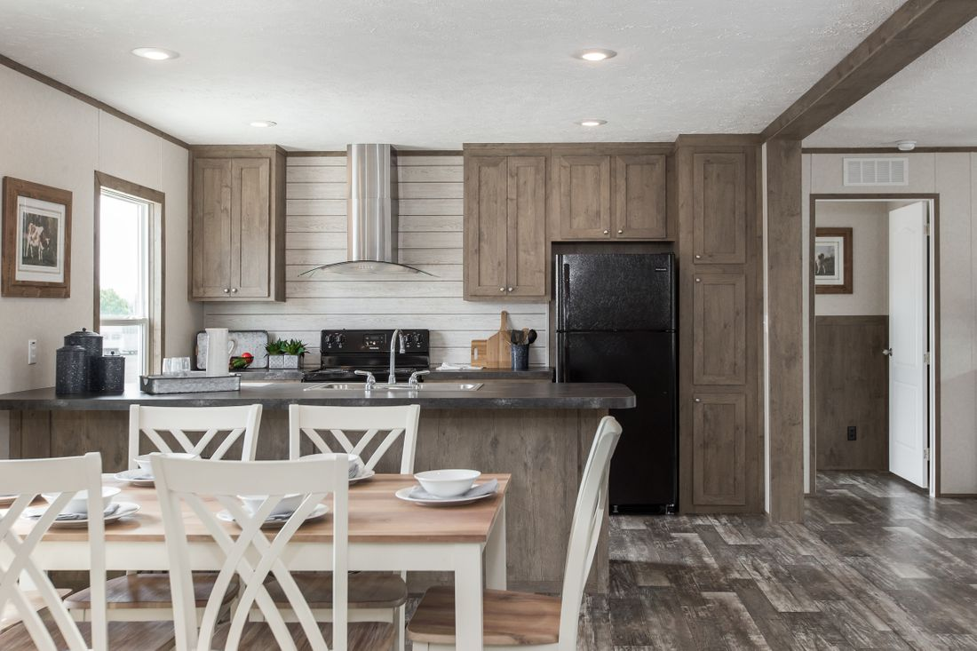 The THE BREEZE II Dining Area. This Manufactured Mobile Home features 4 bedrooms and 2 baths.