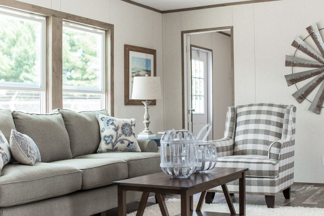 The THE BREEZE II Living Room. This Manufactured Mobile Home features 4 bedrooms and 2 baths.