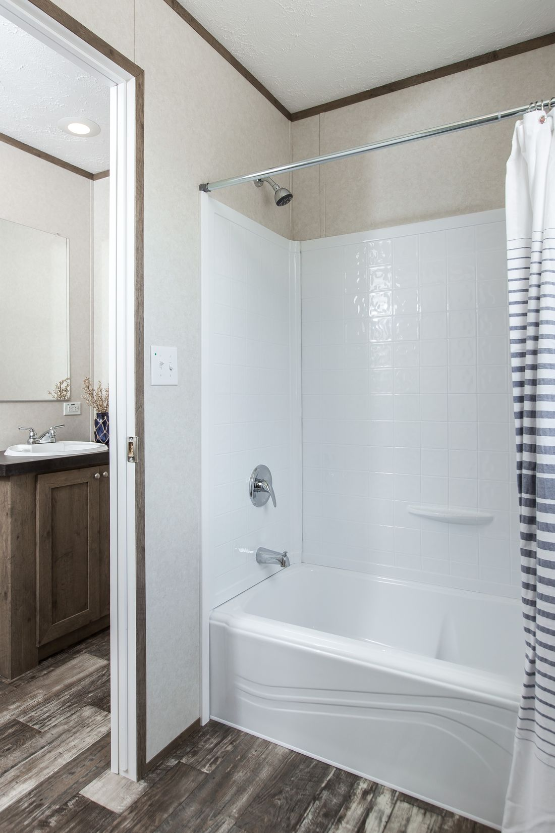 The THE BREEZE II Guest Bathroom. This Manufactured Mobile Home features 4 bedrooms and 2 baths.