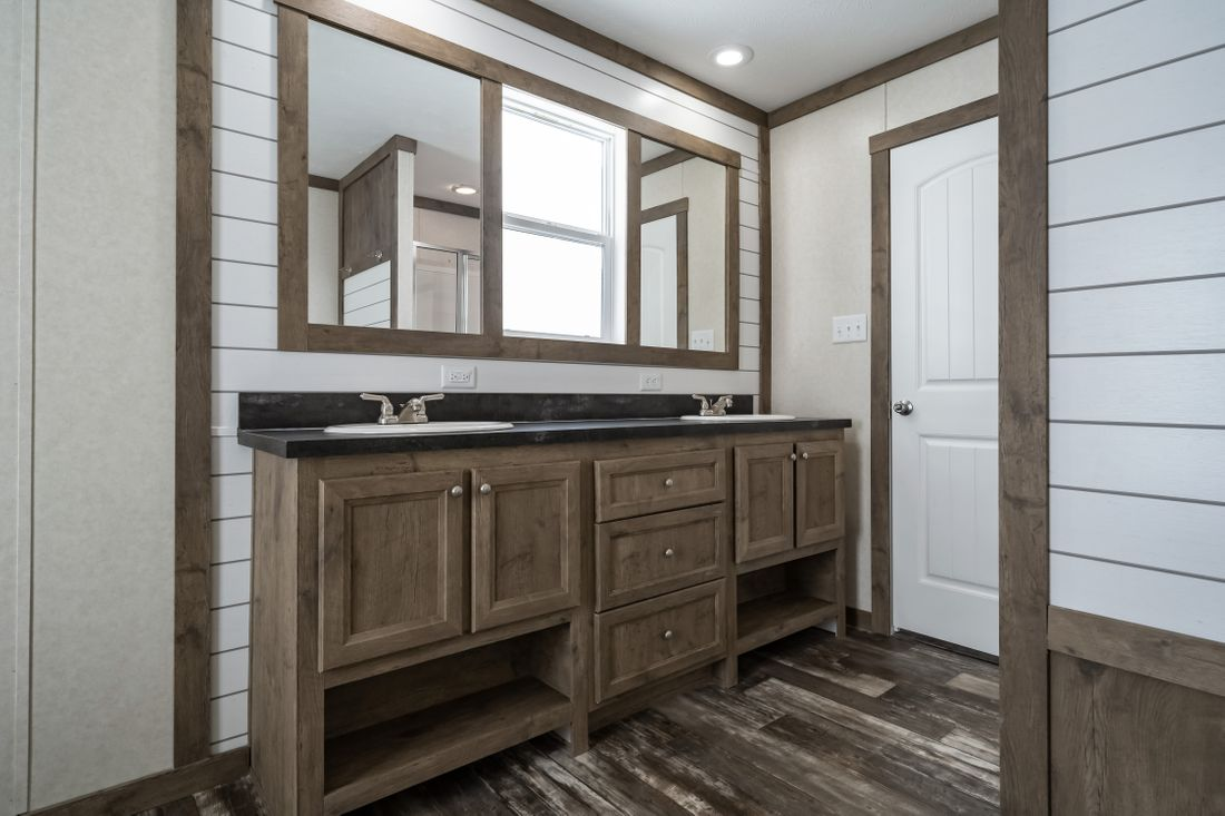 The THE COLUMBUS Master Bathroom. This Manufactured Mobile Home features 4 bedrooms and 2 baths.
