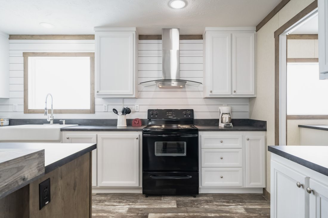 The THE COLUMBUS Kitchen. This Manufactured Mobile Home features 4 bedrooms and 2 baths.