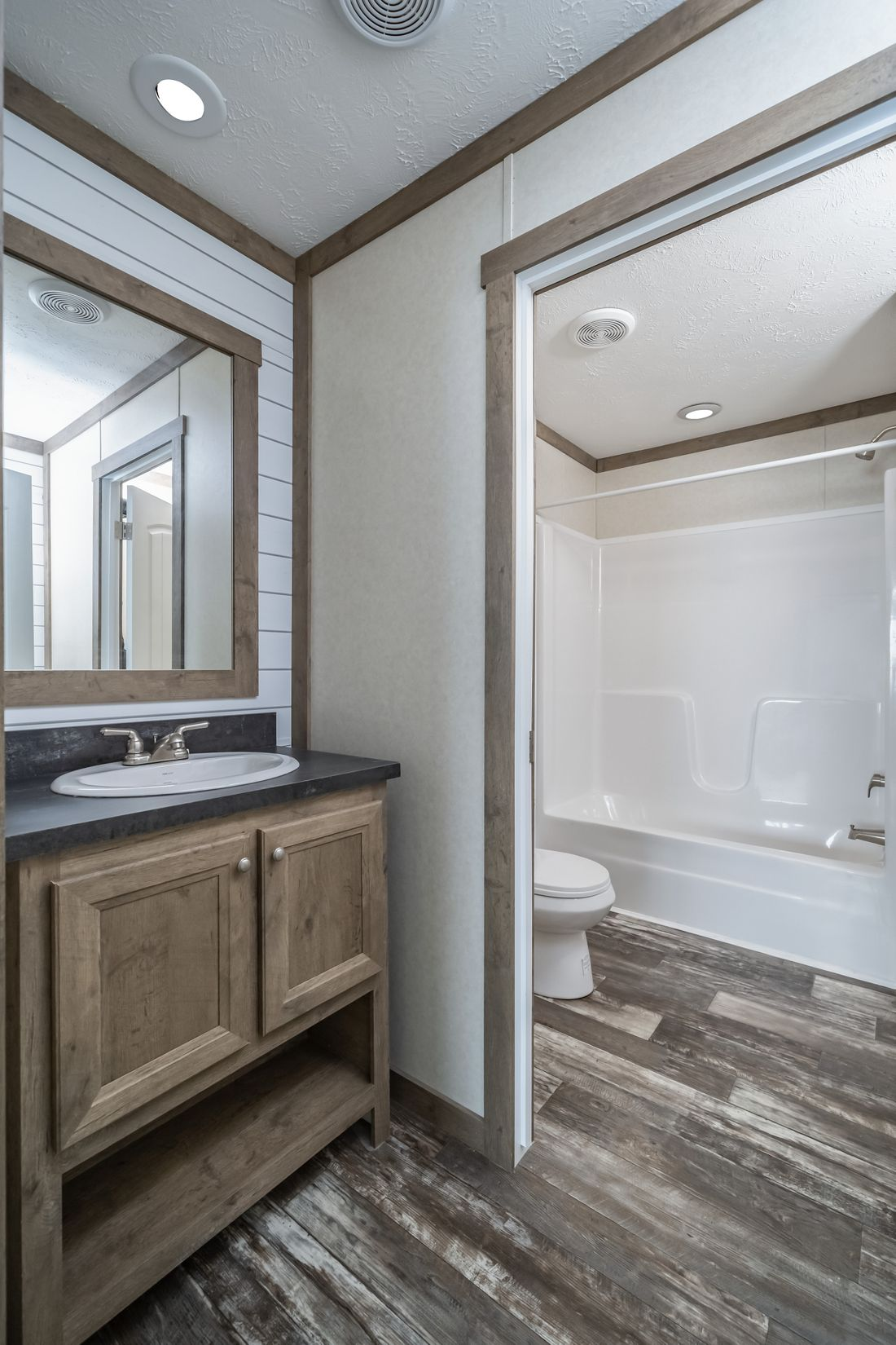 The THE COLUMBUS Guest Bathroom. This Manufactured Mobile Home features 4 bedrooms and 2 baths.