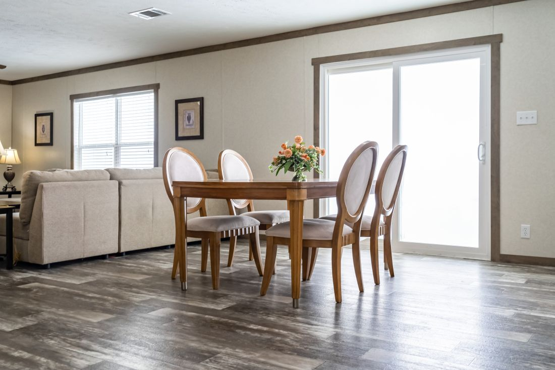 The THE COLUMBUS Dining Area. This Manufactured Mobile Home features 4 bedrooms and 2 baths.