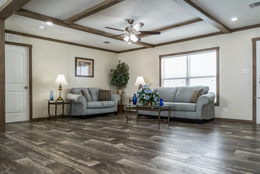 The THE COLUMBUS Living Room. This Manufactured Mobile Home features 4 bedrooms and 2 baths.