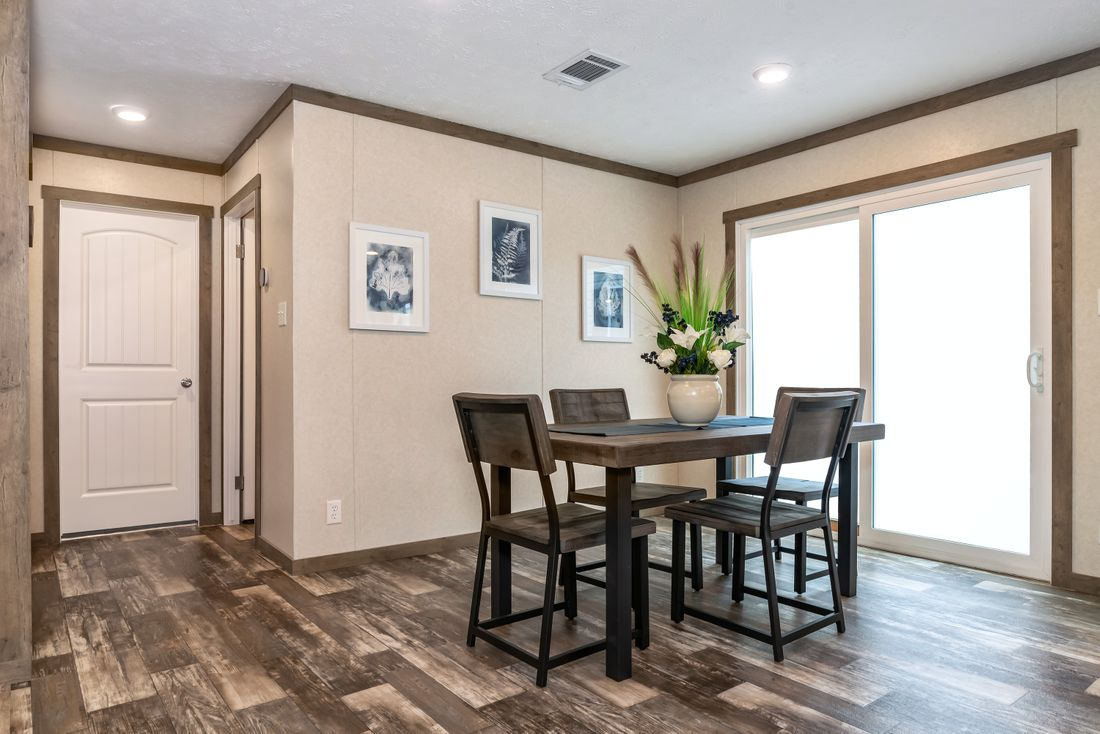 The THE KINGSLAND Dining Area. This Manufactured Mobile Home features 3 bedrooms and 2 baths.
