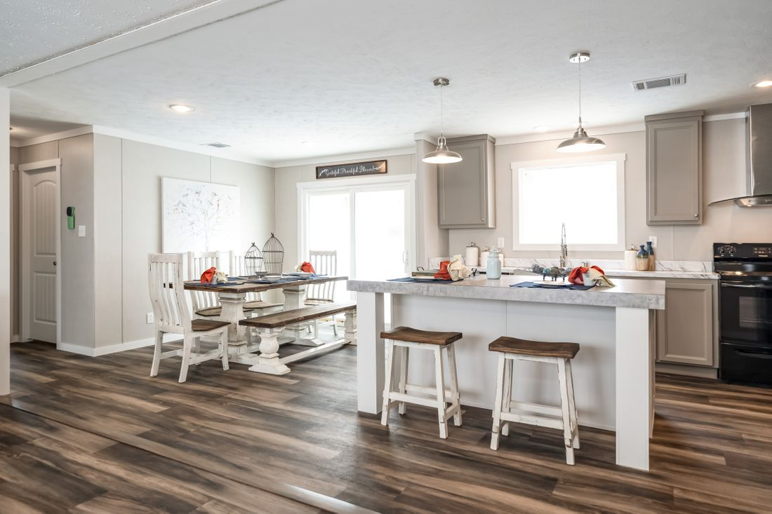 The THE KINGSLAND Kitchen. This Manufactured Mobile Home features 3 bedrooms and 2 baths.
