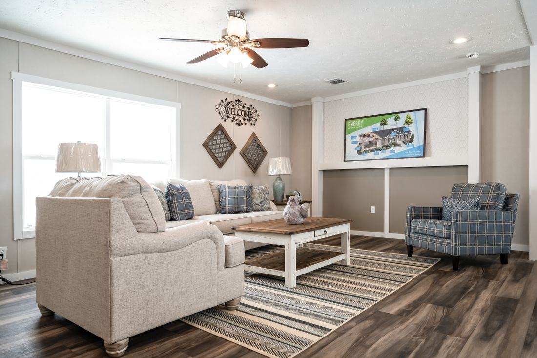 The THE KINGSLAND Living Room. This Manufactured Mobile Home features 3 bedrooms and 2 baths.