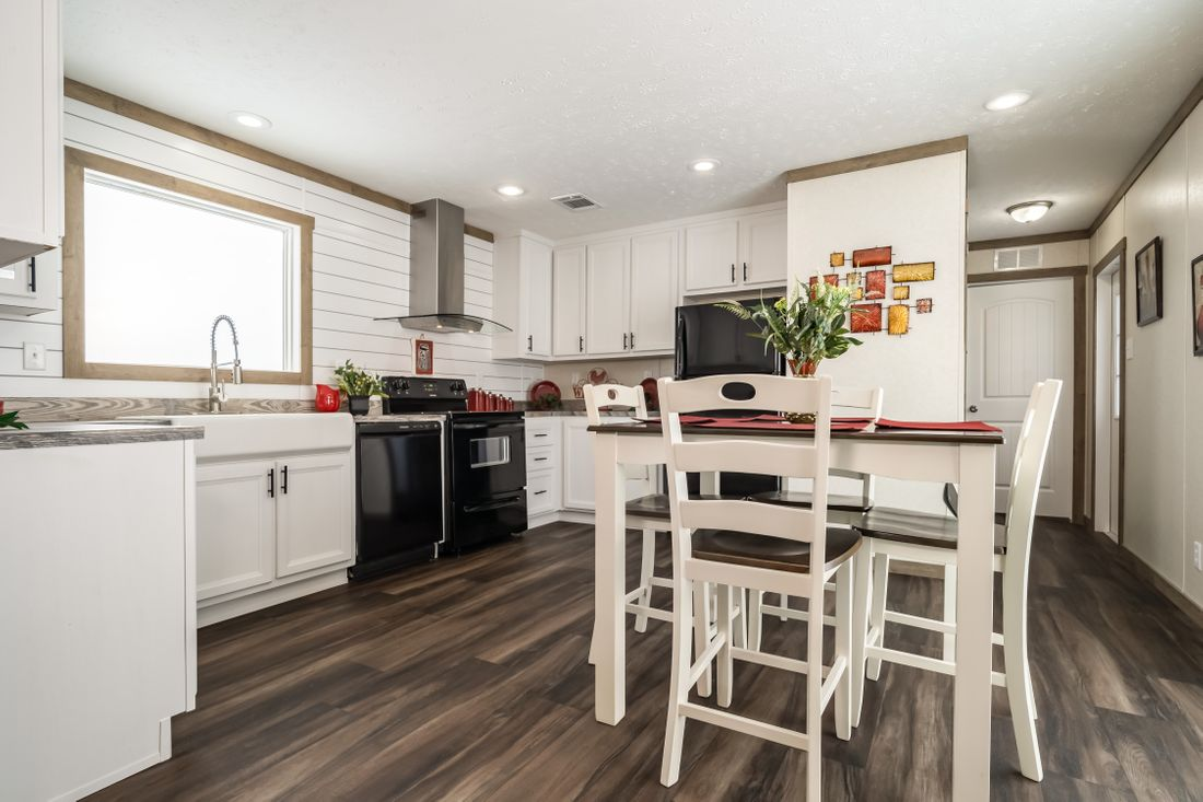 The THE ALBANY Kitchen. This Manufactured Mobile Home features 3 bedrooms and 2 baths.