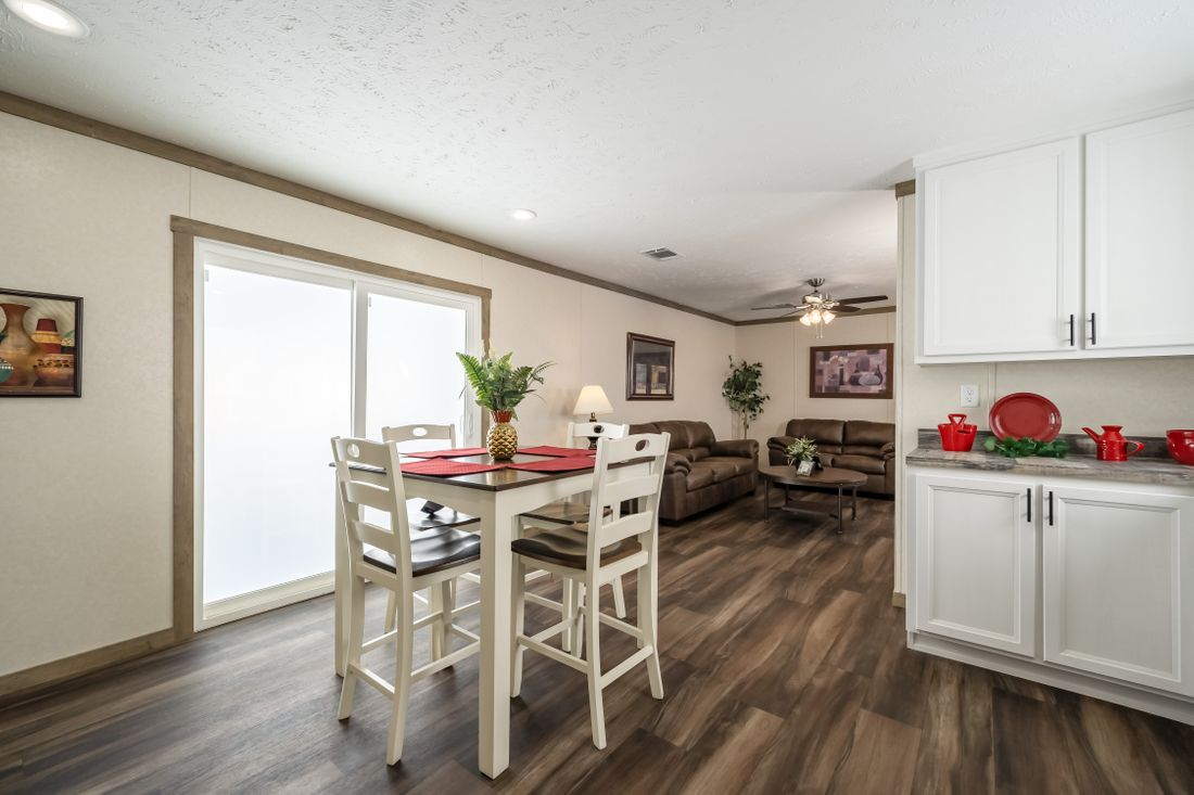 The THE ALBANY Dining Area. This Manufactured Mobile Home features 3 bedrooms and 2 baths.