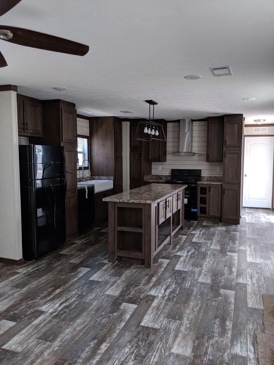 The CS1676-C Kitchen. This Manufactured Mobile Home features 3 bedrooms and 2 baths.