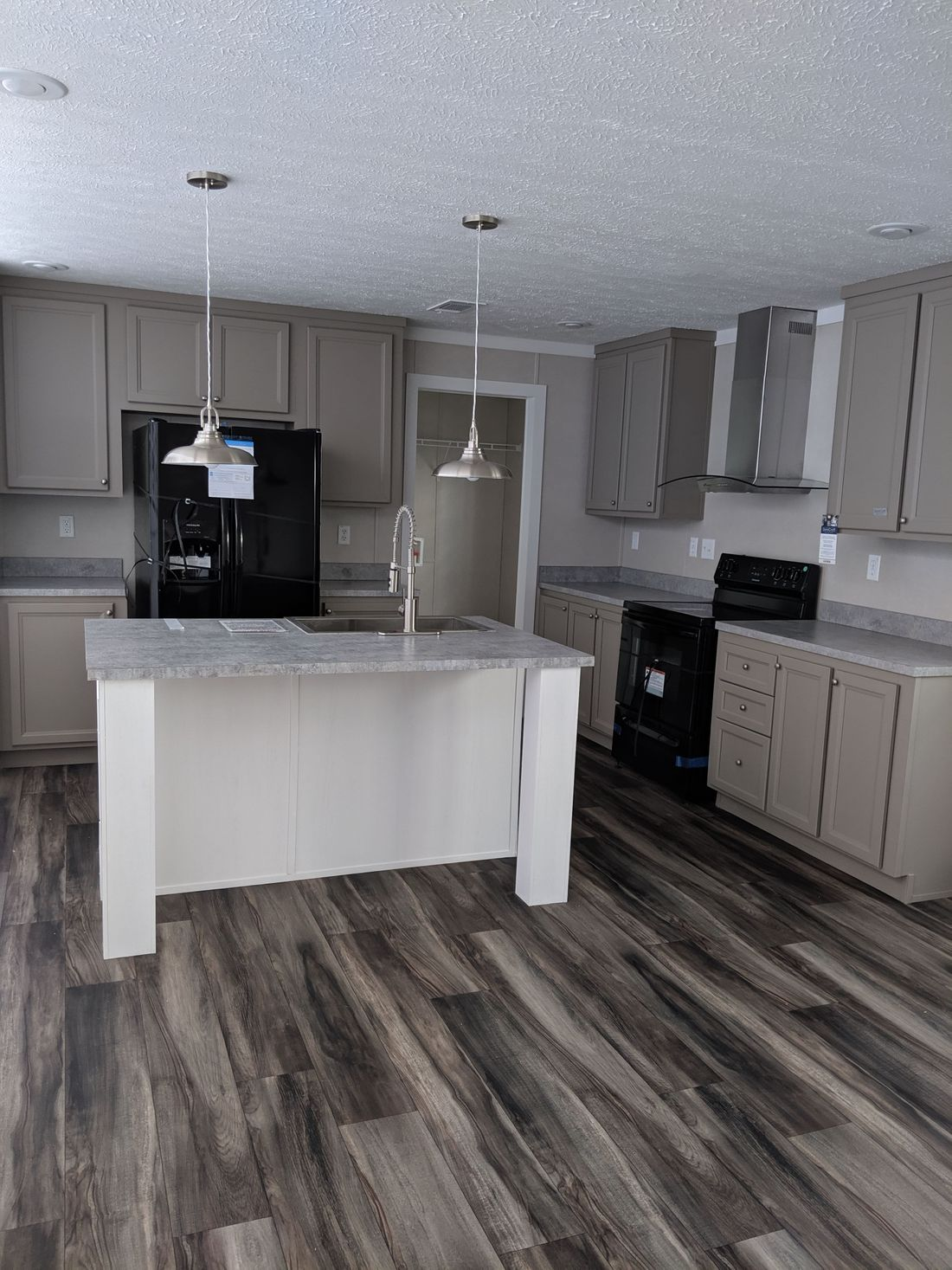 The CS2856-A Kitchen. This Manufactured Mobile Home features 4 bedrooms and 2 baths.
