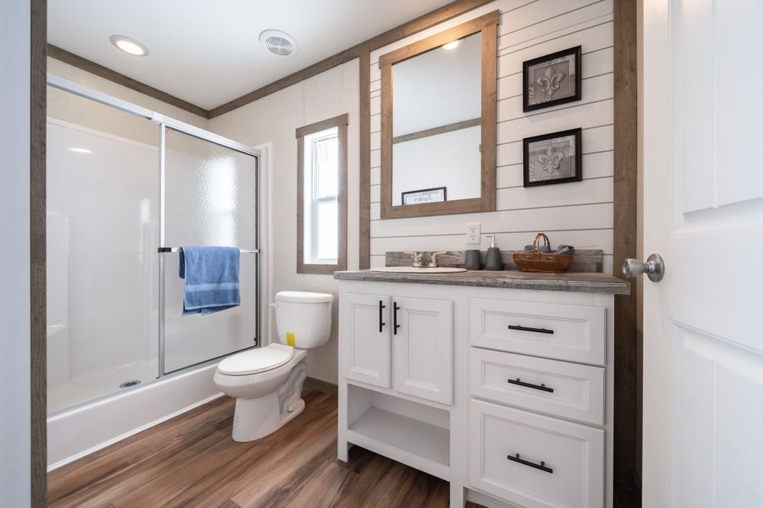 The THE MARIETTA Master Bathroom. This Manufactured Mobile Home features 3 bedrooms and 2 baths.