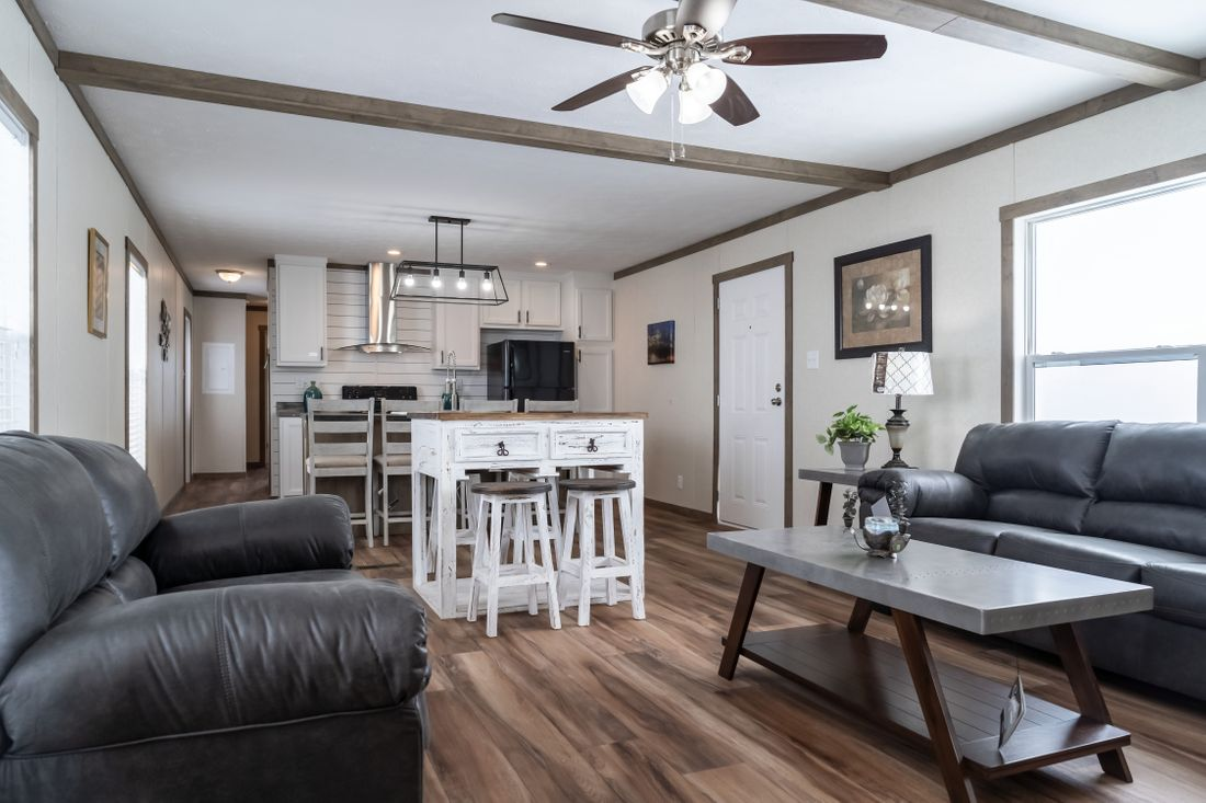 The THE MARIETTA Living Room. This Manufactured Mobile Home features 3 bedrooms and 2 baths.
