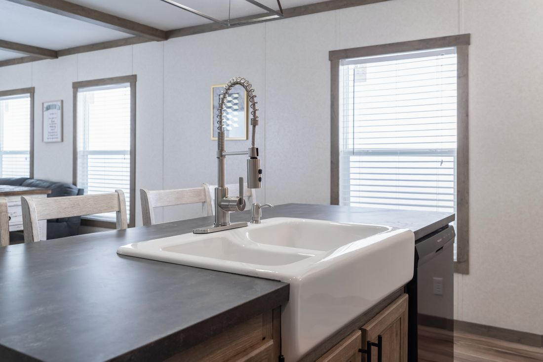The THE MARIETTA Kitchen. This Manufactured Mobile Home features 3 bedrooms and 2 baths.