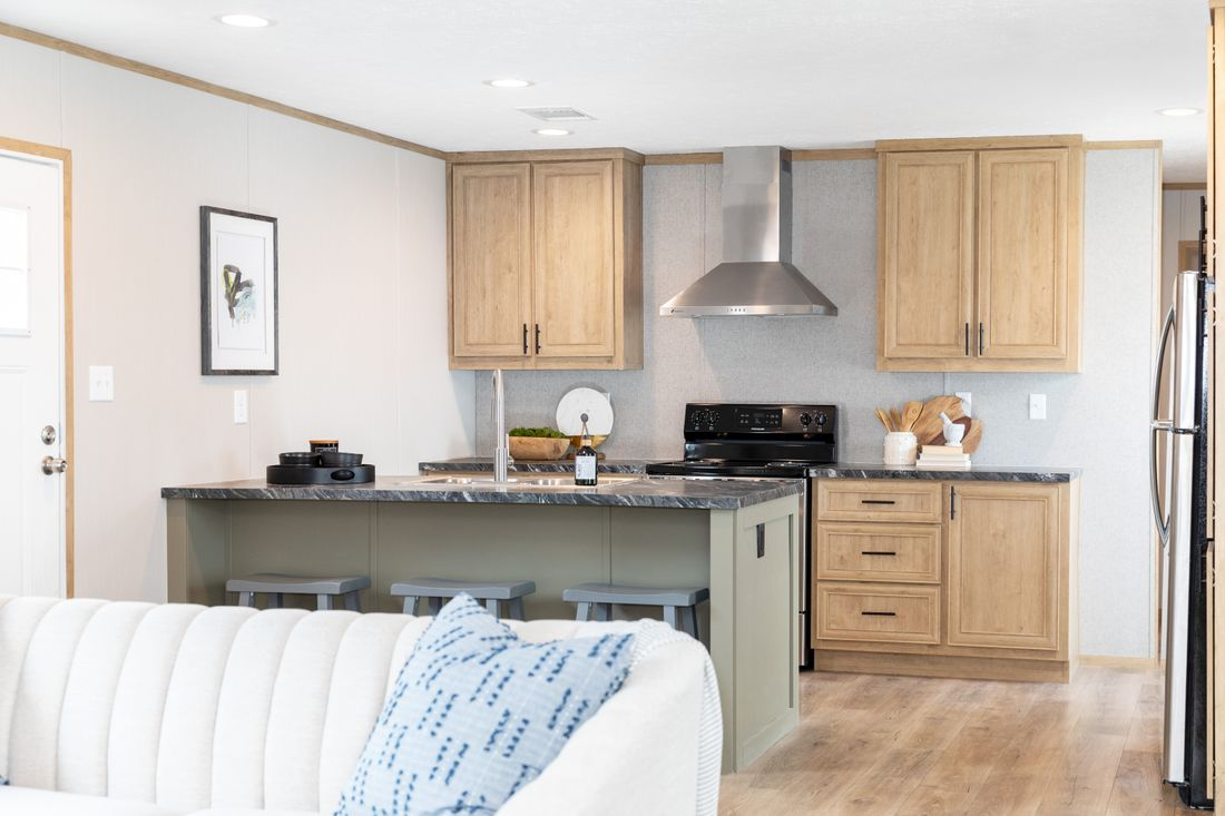 The ODYSSEY Kitchen. This Manufactured Mobile Home features 3 bedrooms and 2 baths.
