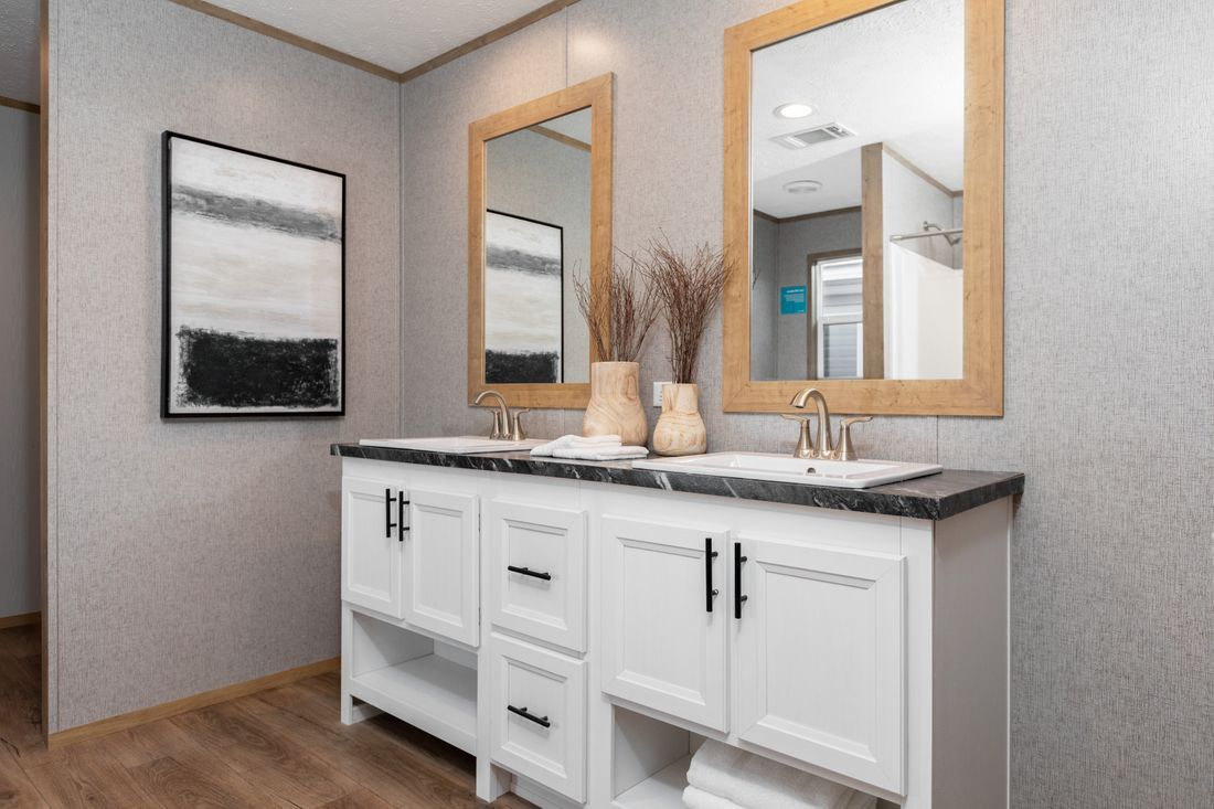 The SAFARI Master Bathroom. This Manufactured Mobile Home features 3 bedrooms and 2 baths.