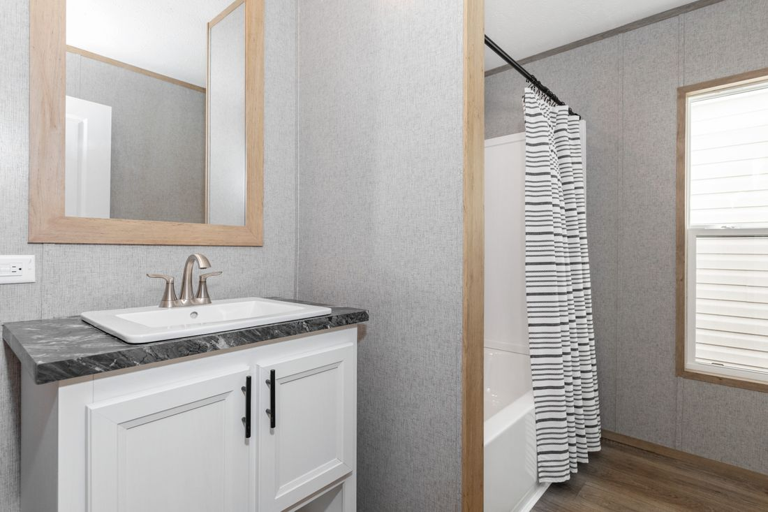 The SUMMIT Guest Bathroom. This Manufactured Mobile Home features 4 bedrooms and 2 baths.