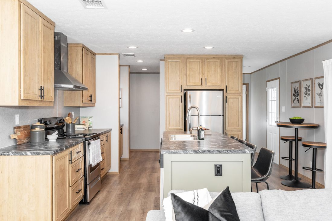 The MARINER Kitchen. This Manufactured Mobile Home features 3 bedrooms and 2 baths.