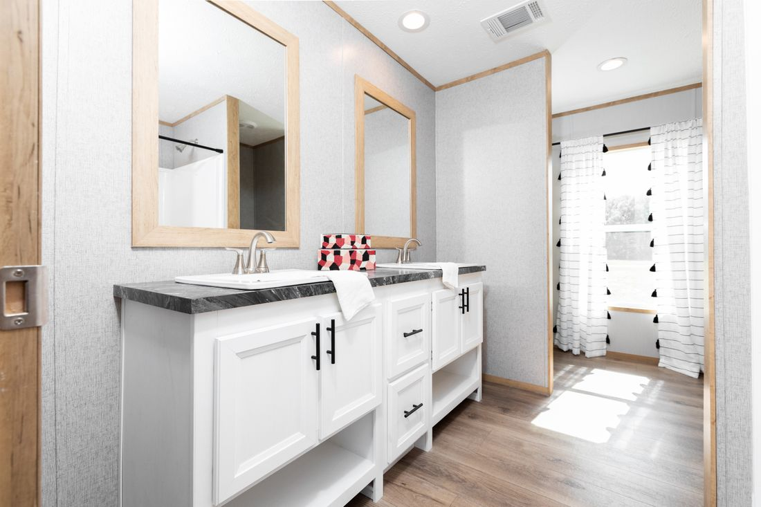 The EXPLORER Master Bathroom. This Manufactured Mobile Home features 3 bedrooms and 2 baths.