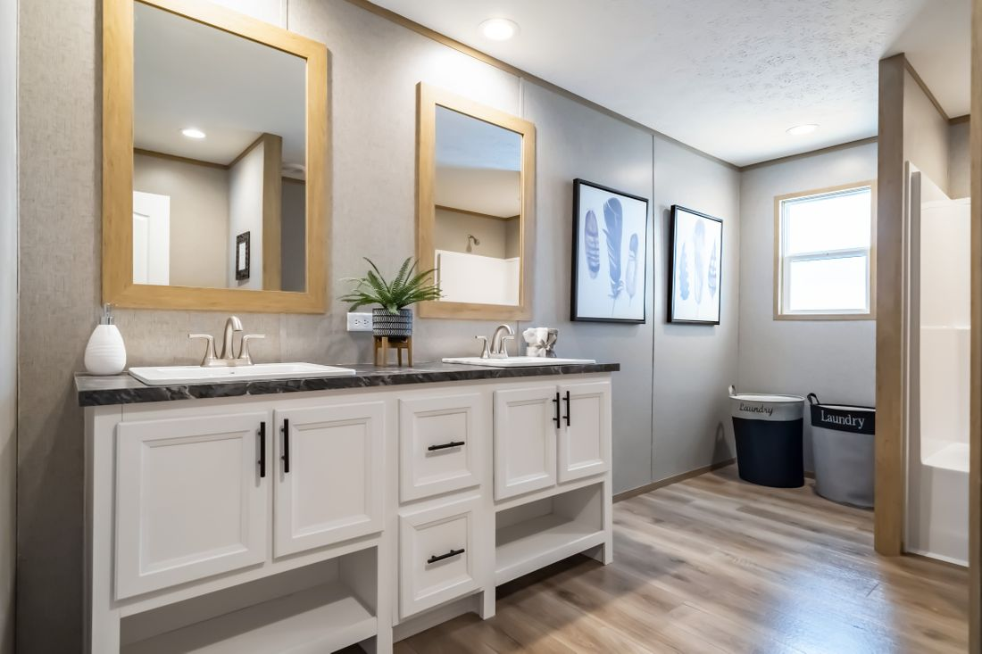 The SUMMIT Master Bathroom. This Manufactured Mobile Home features 4 bedrooms and 3 baths.