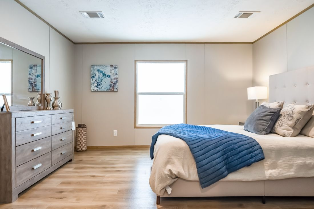 The SUMMIT Master Bedroom. This Manufactured Mobile Home features 4 bedrooms and 3 baths.