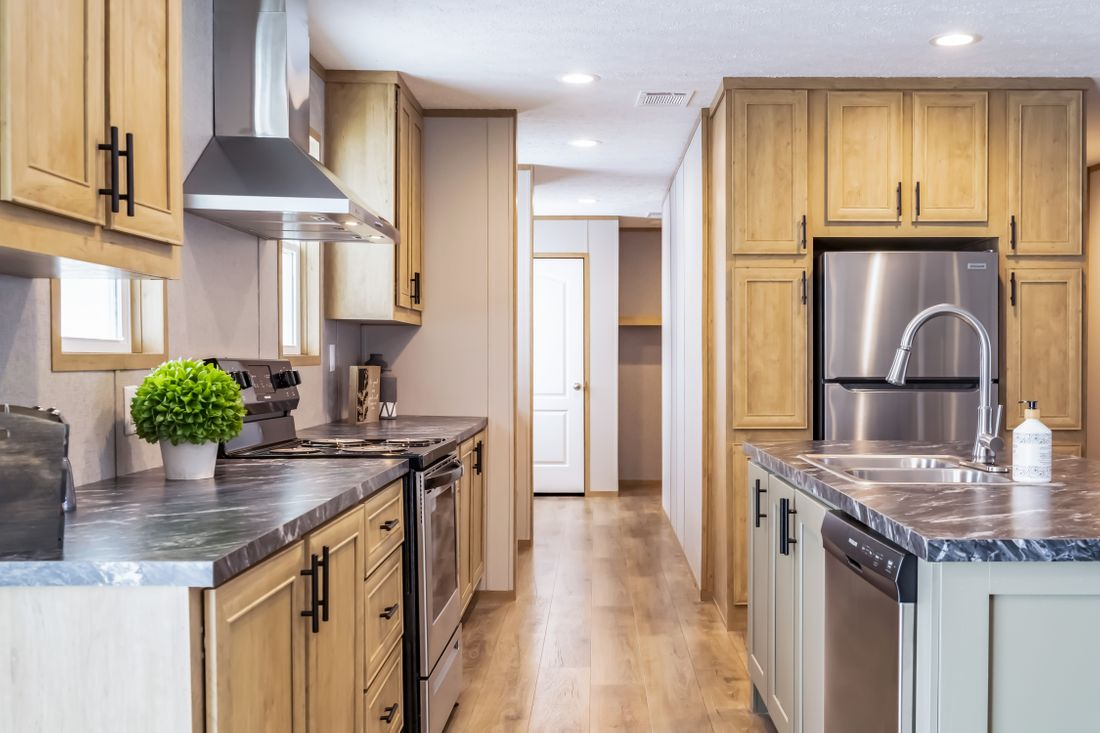The SUMMIT Kitchen. This Manufactured Mobile Home features 4 bedrooms and 3 baths.