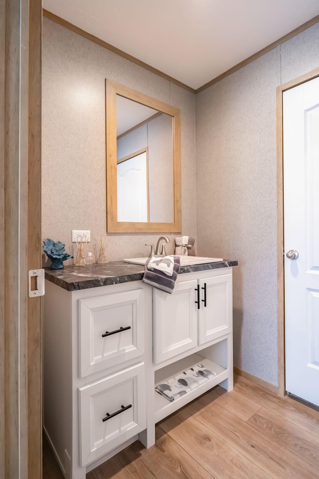 The SUMMIT Guest Bathroom. This Manufactured Mobile Home features 4 bedrooms and 3 baths.