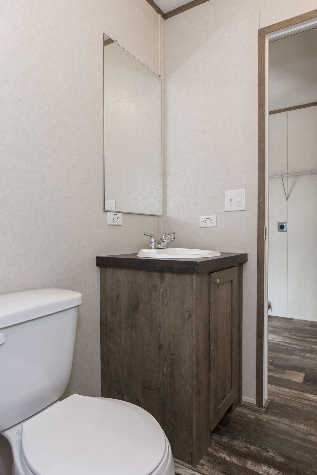 The THE BREEZE Guest Bathroom. This Manufactured Mobile Home features 3 bedrooms and 2 baths.