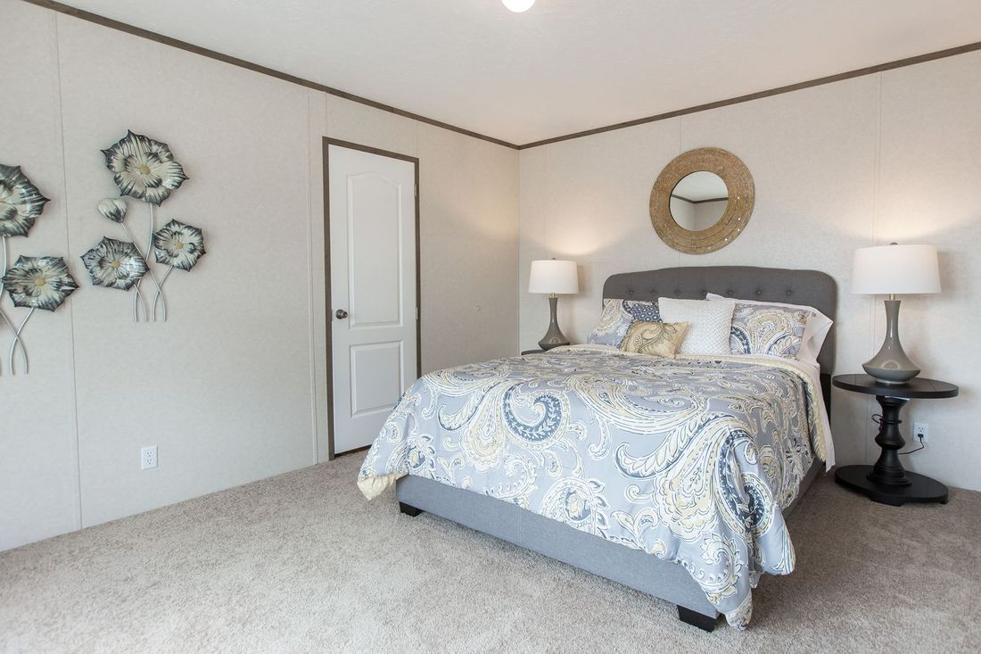 The THE BREEZE Master Bedroom. This Manufactured Mobile Home features 3 bedrooms and 2 baths.