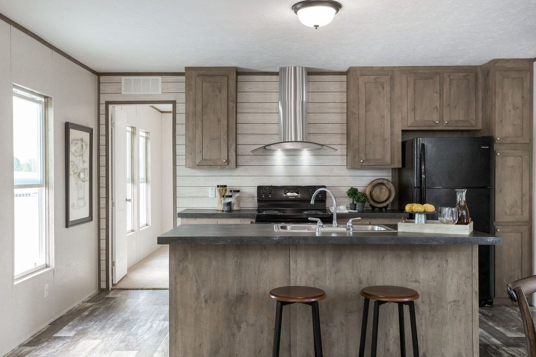 The THE BREEZE Kitchen. This Manufactured Mobile Home features 3 bedrooms and 2 baths.