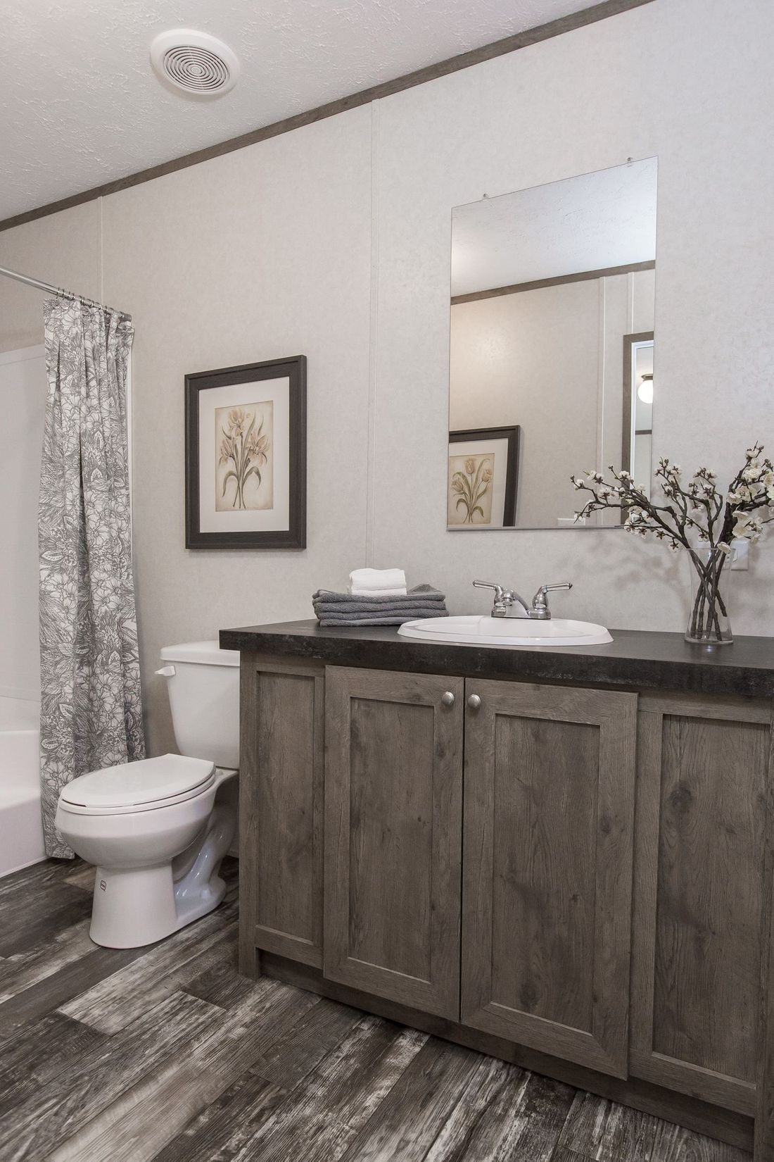 The THE BREEZE Master Bathroom. This Manufactured Mobile Home features 3 bedrooms and 2 baths.